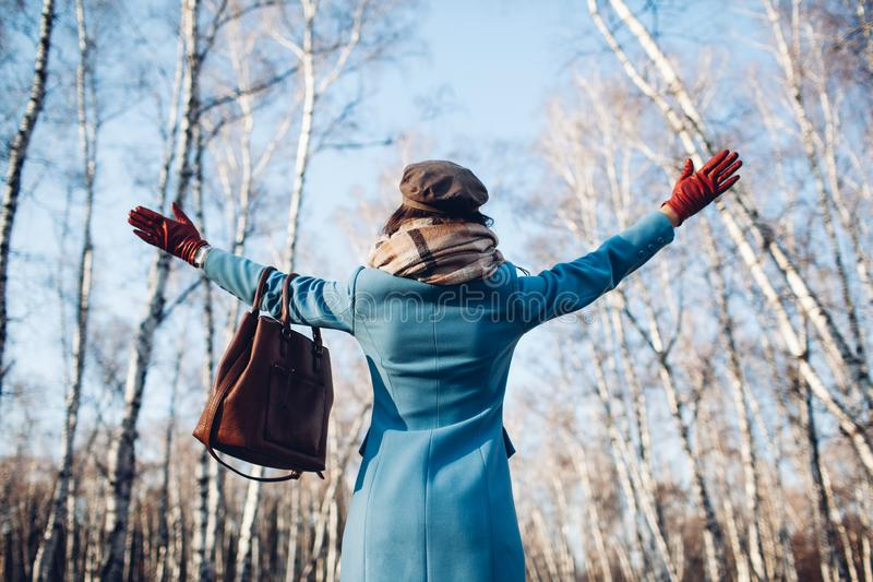 Portrait of young beautiful woman in blye autumn coat. Fashion photo royalty free stock images