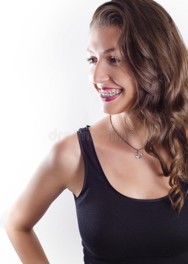 Portrait of young beautiful woman with braces stock photography