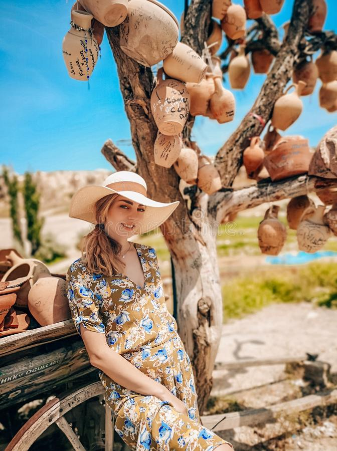 Portrait of a young beautiful woman in Cappadocia with pottery jugs. Goreme royalty free stock photo