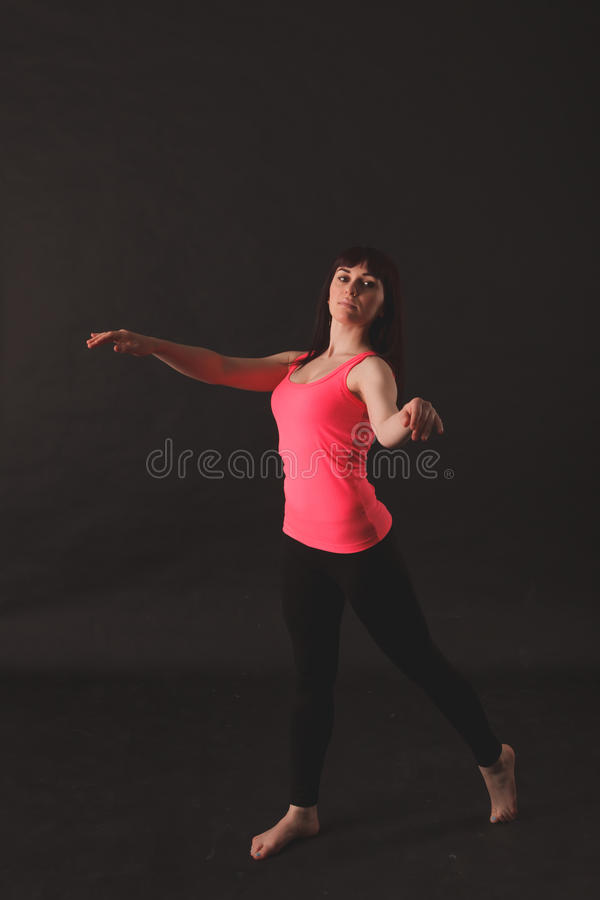 Portrait Of Young Beautiful Woman Dancing royalty free stock photo