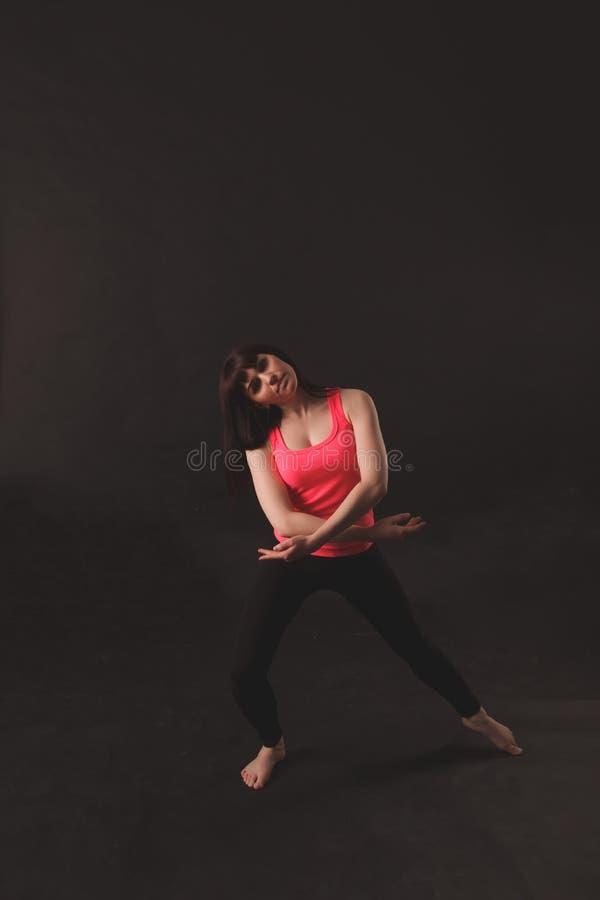 Portrait Of Young Beautiful Woman Dancing stock photo