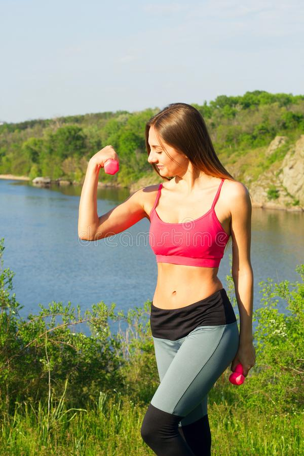 Portrait of young beautiful woman doing sport outside royalty free stock photos
