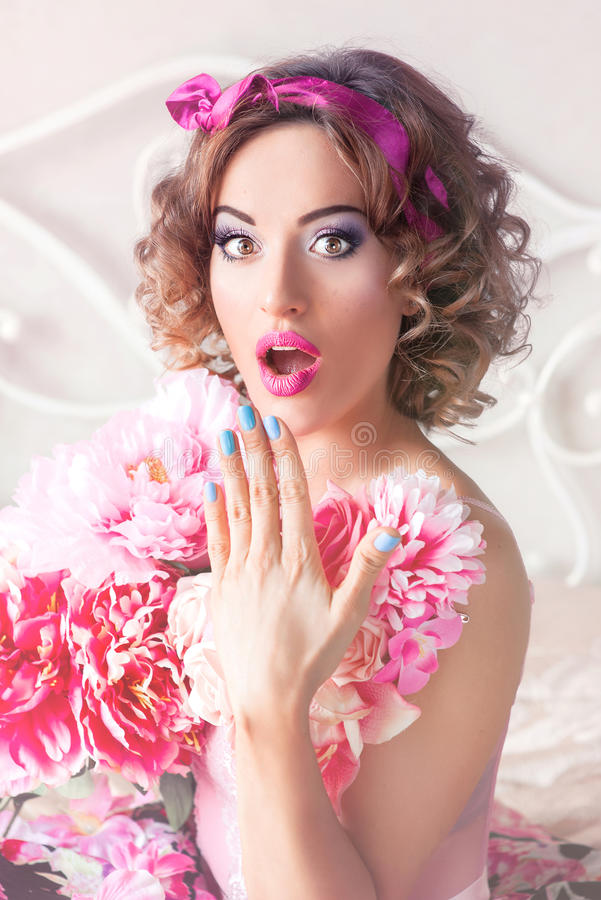 Portrait of young beautiful woman in doll style stock photography