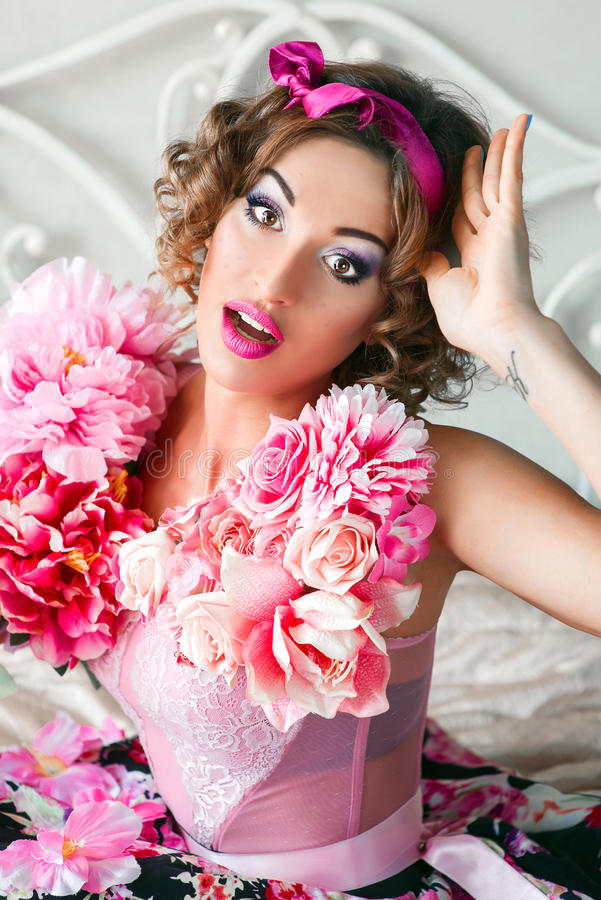 Portrait of young beautiful woman in doll style stock photos