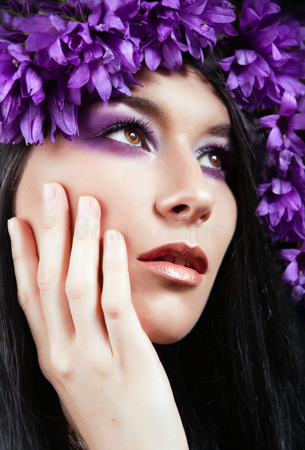 Portrait of young beautiful woman with flowers ar royalty free stock photo