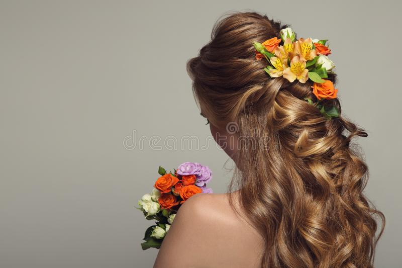 Close up portrait of young beautiful woman with flowers. stock photos