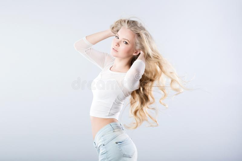 Portrait of young beautiful woman. Flying hair Blond girl stock photo