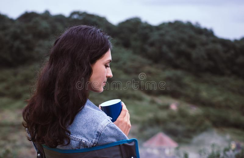 Portrait of young beautiful woman happy and smiling while sitting at outdoor,Travel concept stock photos