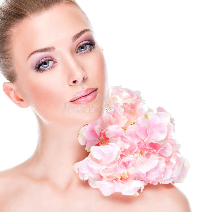 Portrait of young beautiful woman with a healthy clean skin of the face stock image