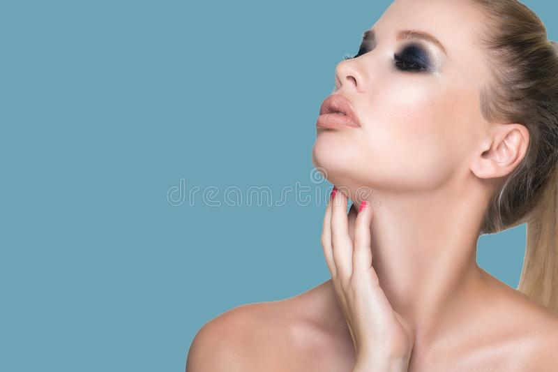 Portrait of a young beautiful woman with healthy and clean skin. Hands touches the neck stock photos