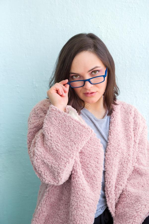 young beautiful woman holding glasses and looking at camera royalty free stock photos