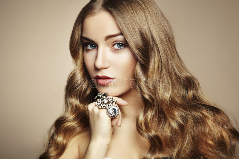 Portrait of young beautiful woman with jewelry royalty free stock photography