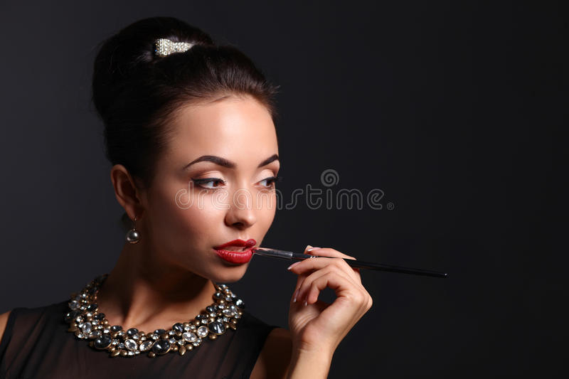 Portrait of young beautiful woman with jewelry.  stock photo