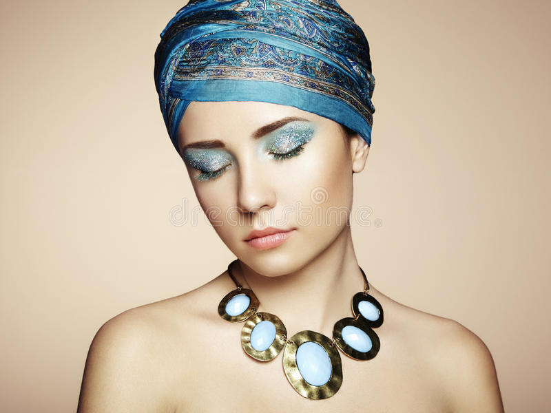 Portrait of young beautiful woman with jewelry stock images