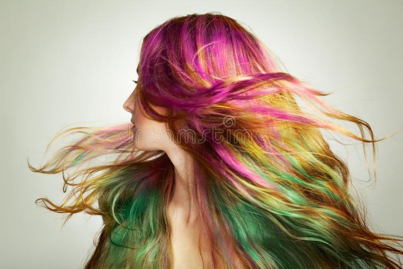 Portrait of young beautiful woman with long flying hair stock photo