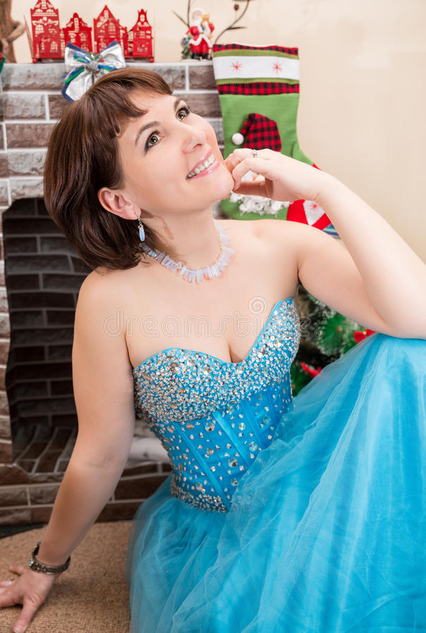 Portrait of the young beautiful woman near the fireplace. Portrait of young beautiful woman near the fireplace stock images