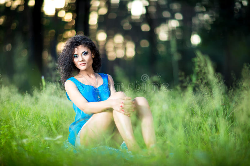 Portrait of the young beautiful woman outdoors stock photography
