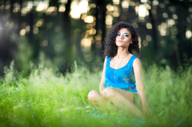 Portrait of the young beautiful woman outdoors stock photos