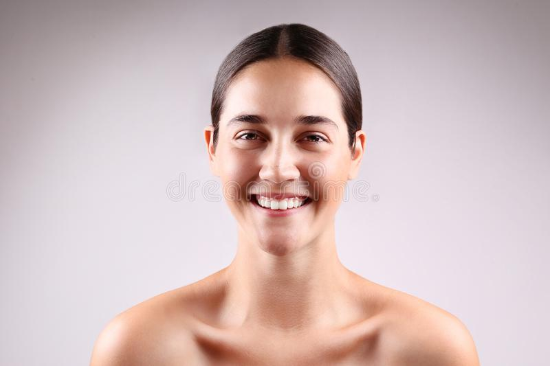Anti acne and wrinkle skincare cream concept, brunette girl with satisfied facial expression royalty free stock images