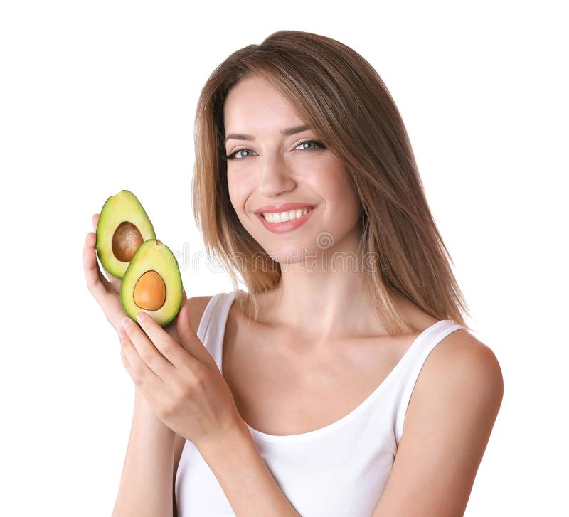 Portrait of young beautiful woman with ripe avocado on white background royalty free stock photography