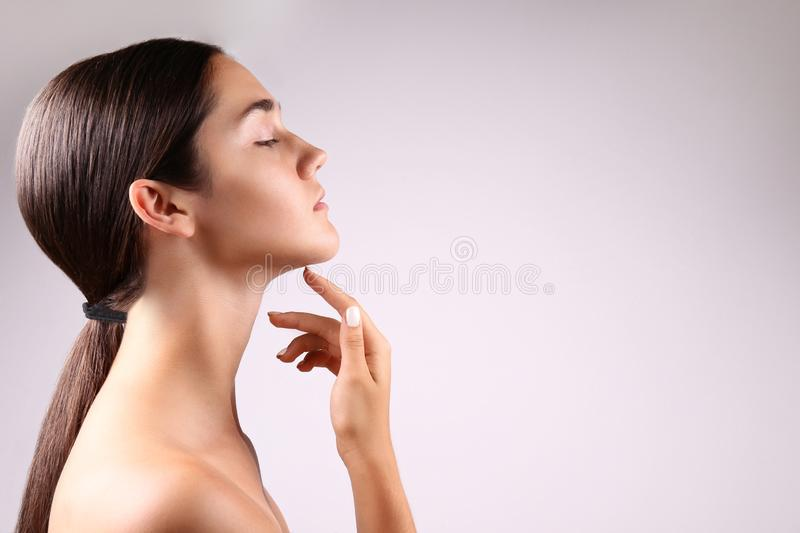 Anti acne and wrinkle skincare cream concept, brunette girl with satisfied facial expression stock photos