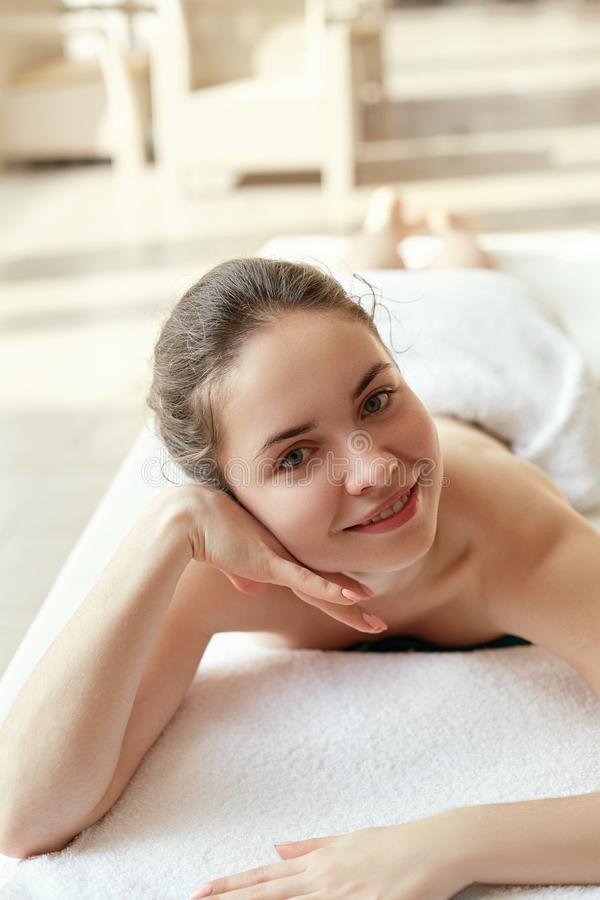 Portrait of young beautiful woman in spa environment. Body care. Spa body. Cosmetology. M. Assage stock photo