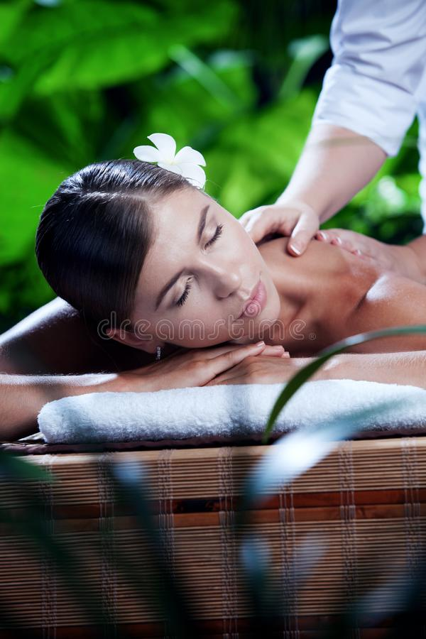 Young beautiful woman in spa environment. Portrait of young beautiful woman in spa environment stock images