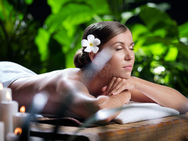 Young beautiful woman in spa environment. Portrait of young beautiful woman in spa environment stock image