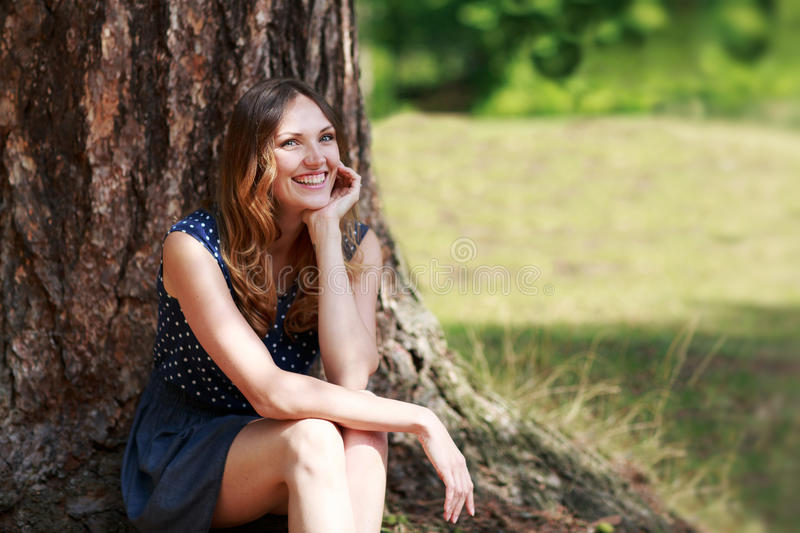 Portrait of young beautiful woman in summer forest royalty free stock photo