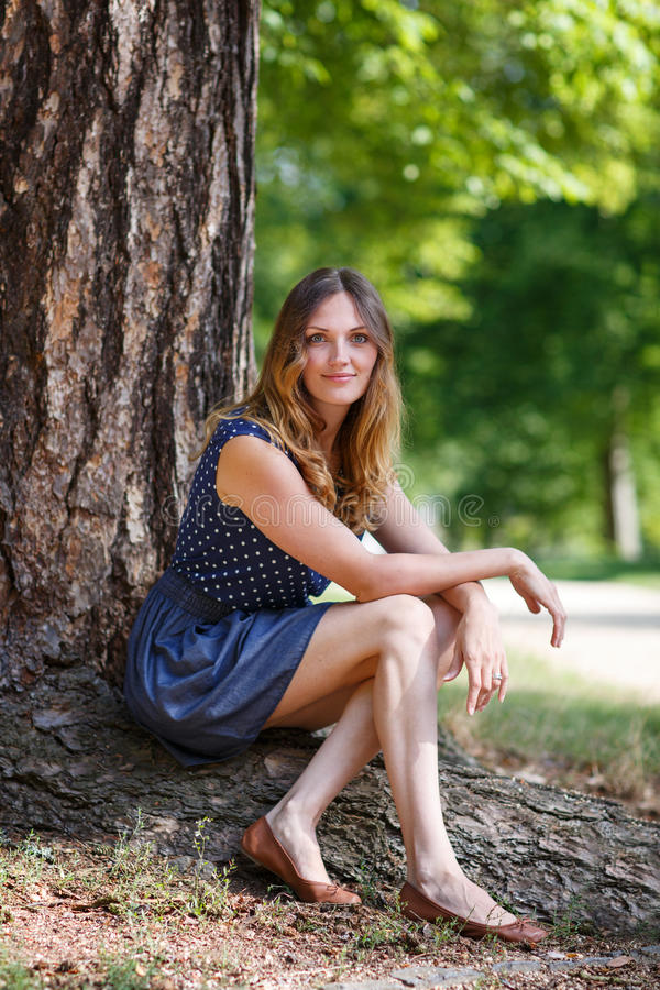 Portrait of young beautiful woman in summer forest royalty free stock photos
