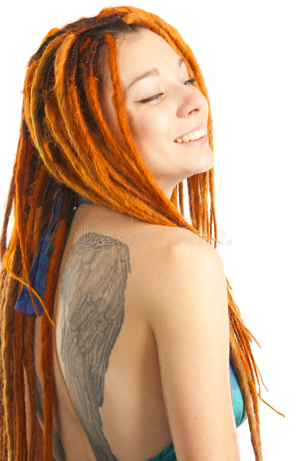 Portrait of young beautiful woman with tattoo. Of wings on her back stock photography