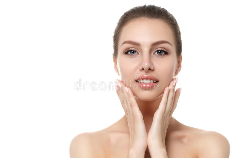 Portrait of young beautiful woman touching her face royalty free stock photography