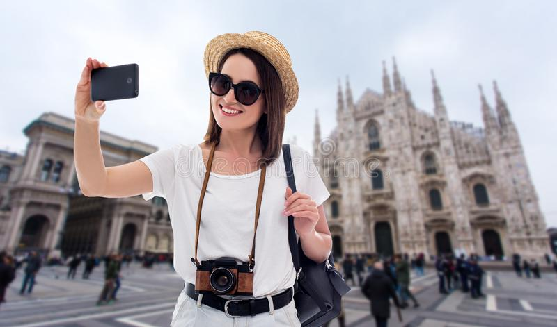 Portrait of young beautiful woman tourist taking selfie photo in Milan, Italy stock images
