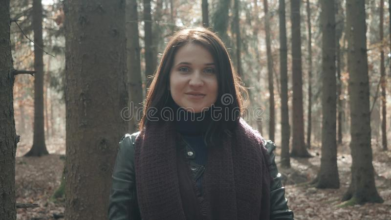 Portrait of Young Beautiful Woman Walking In Autumn Park. Girl Walking In Forest In Fall, Lifestyle Concept royalty free stock image