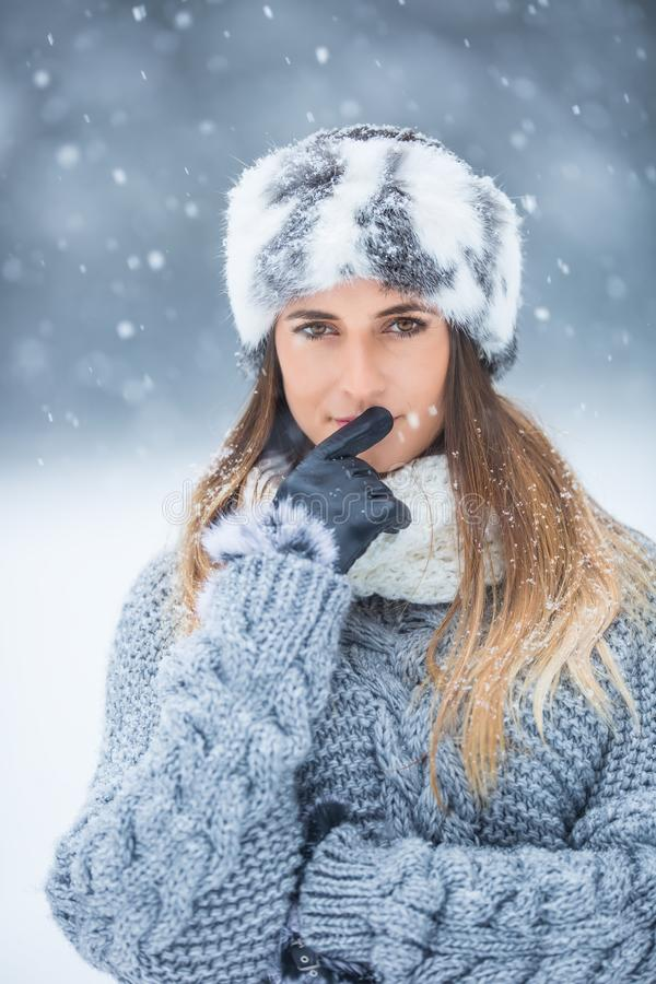 Portrait of young beautiful woman in winter clothes and strong snowing.  stock image