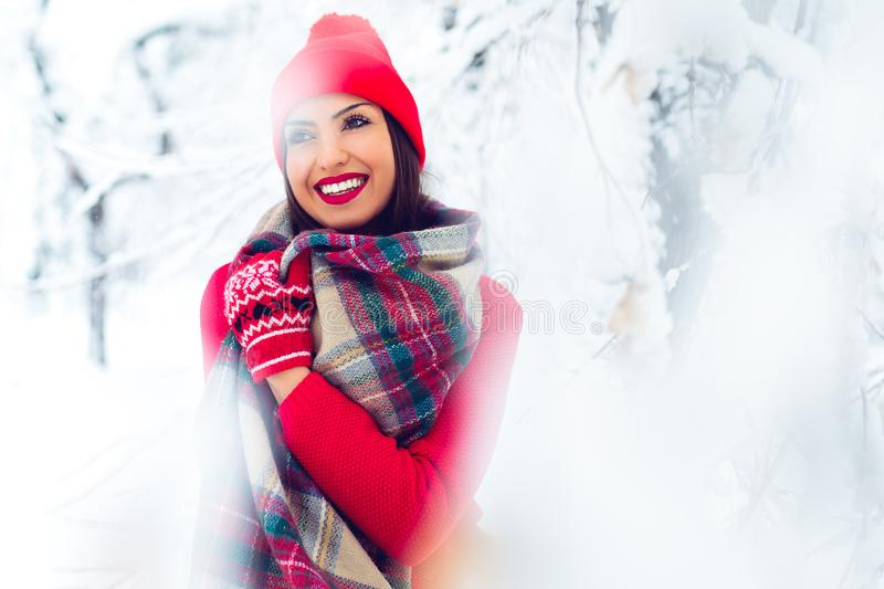 Portrait of young beautiful woman in winter time - Image. Beautiful young woman in winter park - Image stock photos