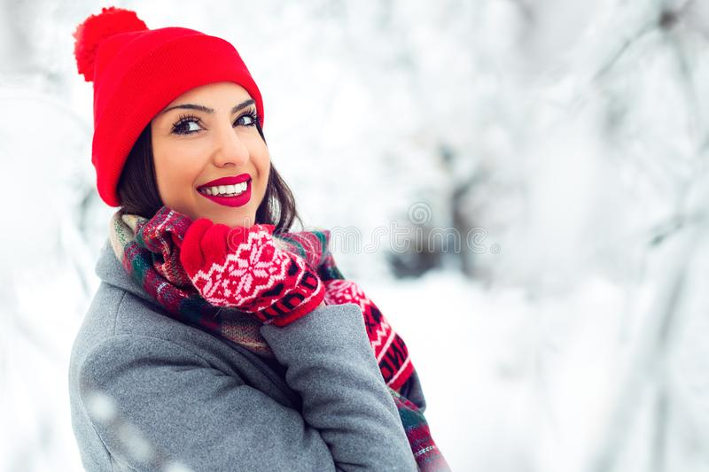 Portrait of young beautiful woman in winter time - Image stock photography