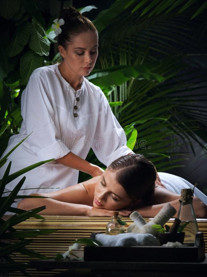 Portrait of young beautiful woman in spa stock images