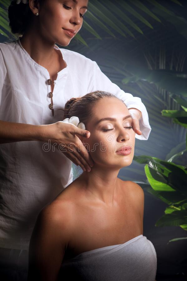 Of young beautiful woman in spa environment. royalty free stock photography