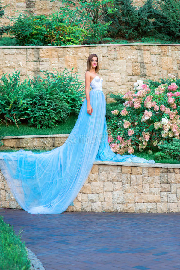 Portrait of young beautilul woman in long blue dress royalty free stock photos