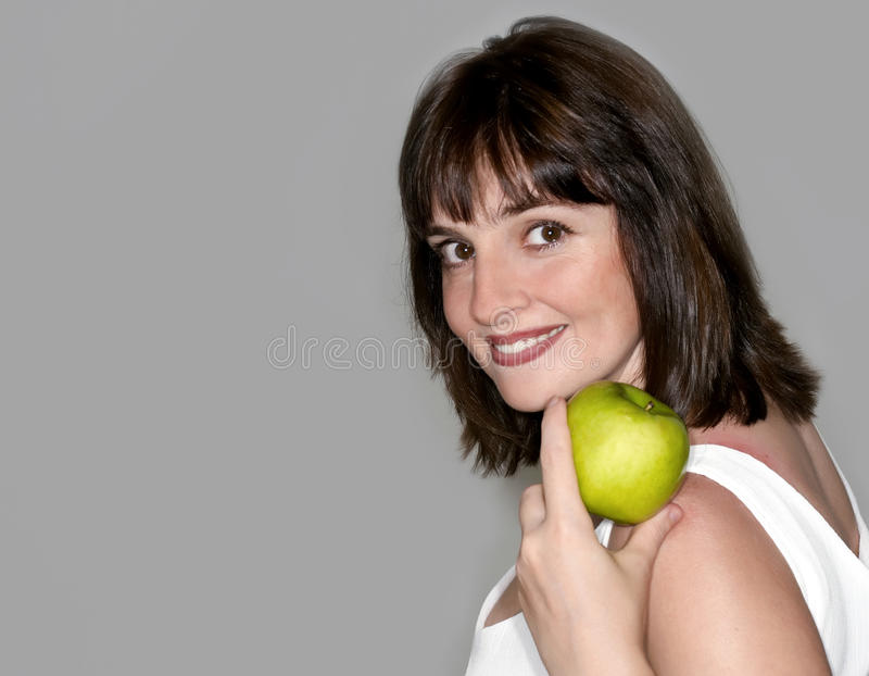 Download Portrait Of Young Beauty Woman With Green Apple Stock Photo - Image of health, friendly: 13046092