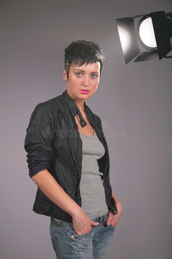 Portrait of young beauty woman in photostudio stock photos