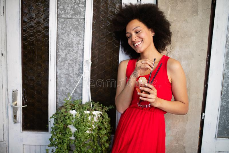 Portrait of a young black woman, model of fashion wearing dress with afro hairstyle stock photos