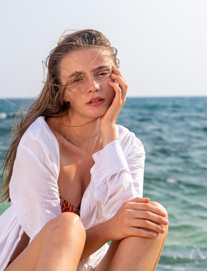 Portrait of a Young beautiful caucasian blond at the beach royalty free stock photography