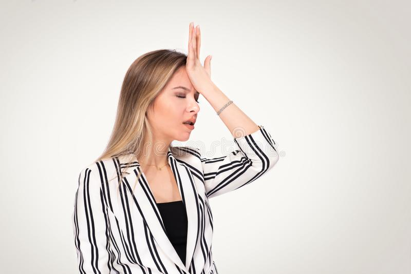 Portrait of Young Blond Business Woman Who is Shocked and Unhappy royalty free stock photo