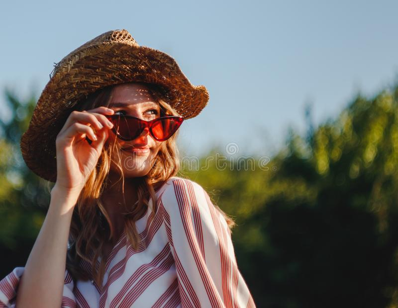 Portrait of a young blond country girl with vintage retro sun glasses stock photo