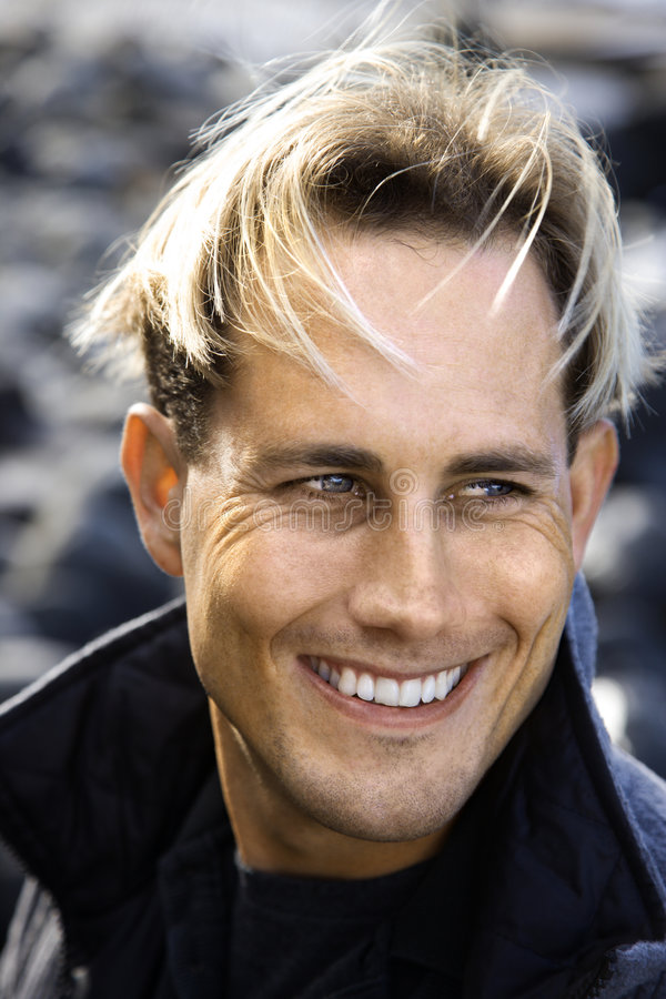 Portrait of young blond man