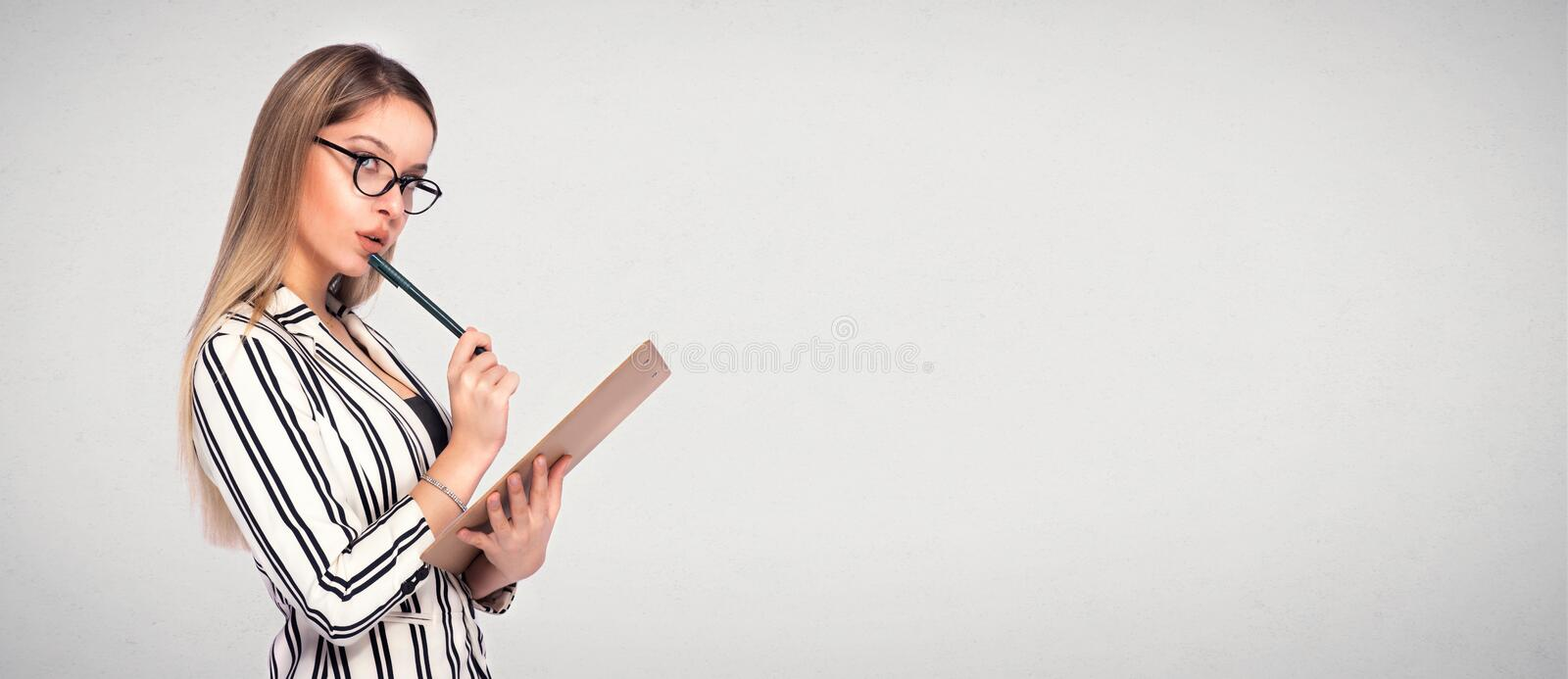 Portrait of Young Blond Secretary Taking Notes with Copy Space stock images