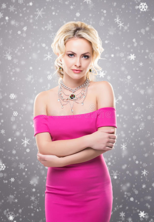 Portrait of a young blond woman in jewelry royalty free stock images