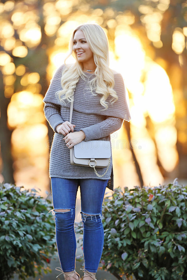 Portrait of young blond woman outdoors royalty free stock photos